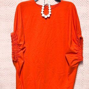 One size fits most oversize Zara shirt.